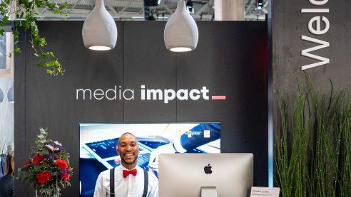 Media Impact Eingang am gemeinsamen Stand mit AdA